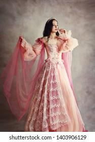 beautiful brunette princess peach pink dress painterly look old fashion