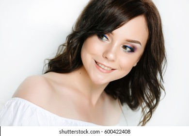 Beautiful brunette with professional make-up and permanent