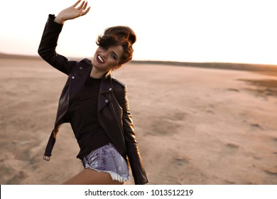 Beautiful brunette sexy,tourist at America ,woman in leather jacket and red full lips,white teeth,hand up,posing on camera,spring outfit,lovely style,cool woman,volume hair,blogger,frame.filter