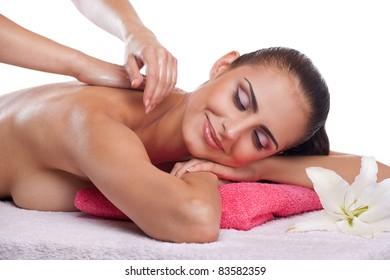 Beautiful brunette spa woman getting massage on towel in spa salon