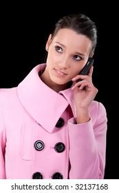 Beautiful brunette speaks by mobile phone.