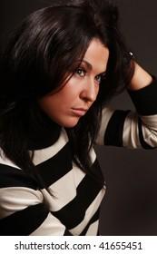 beautiful brunette in striped sweater