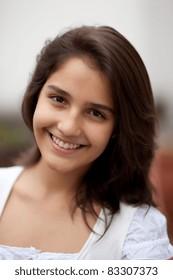 Beautiful brunette teenage girl. Nice bokeh. Very shallow depth of field.
