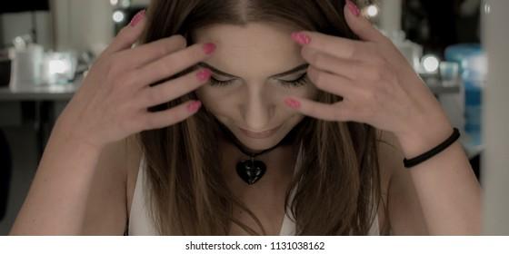 Beautiful brunette touching her hair