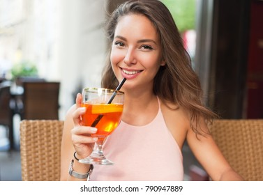 Beautiful brunette tourist woman in a local restaurant.