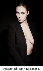 Beautiful brunette womam posing in costume on black. Model, portrait, natural big eyes emotion white skin