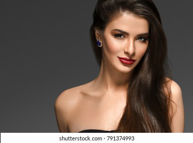 Beautiful brunette woman with beauty healthy hairstyle and red lips portrait over dark background