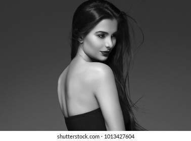 Beautiful Brunette Woman Beauty Model Girl with perfect makeup and hairstyle black and white