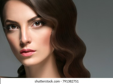 Beautiful Brunette Woman Beauty Model Girl with perfect makeup and hairstyle