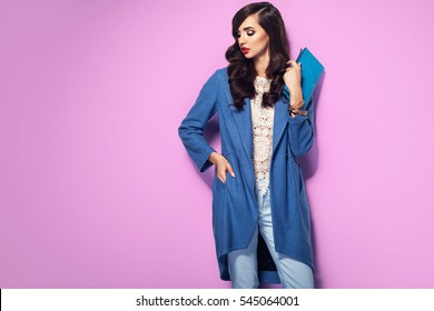 Beautiful brunette woman in a blue coat and nice top. Fashion spring autumn winter photo