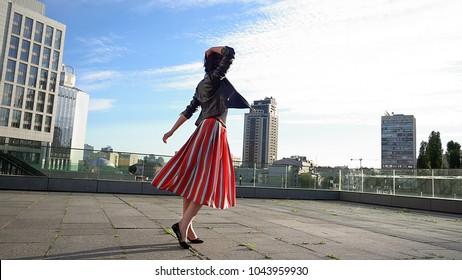 75d6f66019 Beautiful brunette woman is dancing feeling happy outdoors. City life urban  young happy people behavior