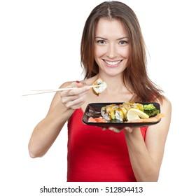 beautiful brunette woman eating sushi