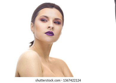 Beautiful brunette woman face studio on white. high key portrait