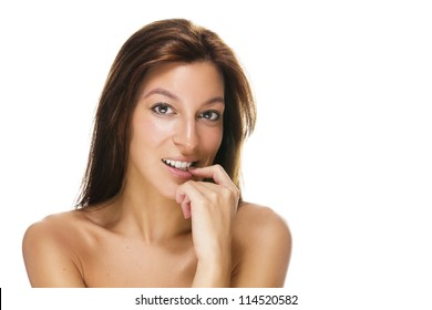 beautiful brunette woman with a finger at her mouth on white background