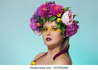 Beautiful brunette woman with flower wreath on her head.