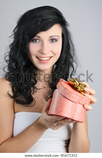 Beautiful brunette woman with a gift box