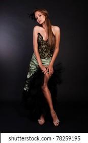 beautiful brunette woman in green dress