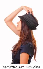 Beautiful brunette woman in a hat