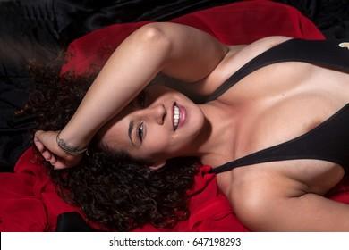 beautiful brunette woman in her bedroom