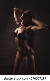 Beautiful brunette woman in lingerie underwear in rich elegant interior in sexy fashion poses. indoor. studio