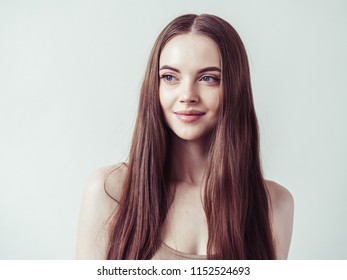 Beautiful brunette woman with long smooth natural hair female model happy and beauty over white background - Shutterstock ID 1152524693