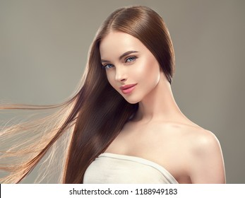Beautiful brunette woman with long smooth hair beauty hairstyle female portrait