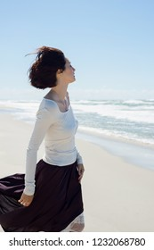 Beautiful brunette woman near the sea in motion