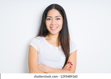 Beautiful brunette woman over isolated background happy face smiling with crossed arms looking at the camera. Positive person.