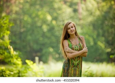 Beautiful brunette woman in a park.