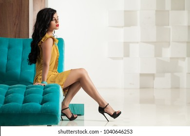 Beautiful Brunette Woman with Perfect Legs. Cute Model Wearing Black High Heels Shoes