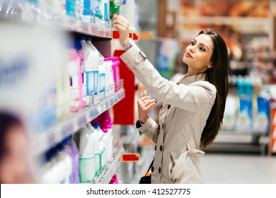 Beautiful  brunette woman shopping in supermarket