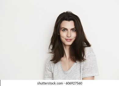 Beautiful brunette woman smiling, portrait