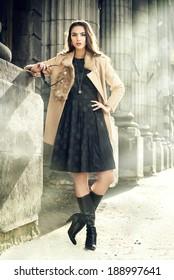 Beautiful brunette woman standing on the city street.