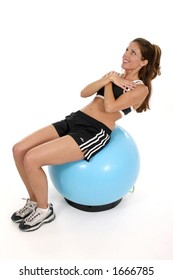 Beautiful brunette woman using an exercise ball to workout.  Shot isolated on white background.