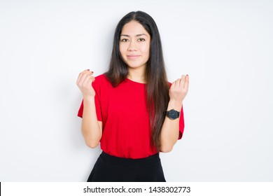 Beautiful brunette woman wearing red t-shirt over isolated background Doing money gesture with hand, asking for salary payment, millionaire business