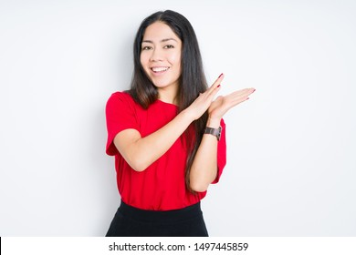 Beautiful brunette woman wearing red t-shirt over isolated background Clapping and applauding happy and joyful, smiling proud hands together