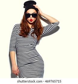 beautiful brunette young woman model in summer  zebra dress in black beanie