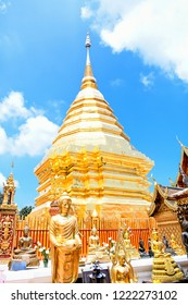 Beautiful buddha image and golden pagoda with blue clear sky and white clouds,  Phra That Doi Suthep  Temple ,the famous place for thai people and buddhist in chiangmai Thailand