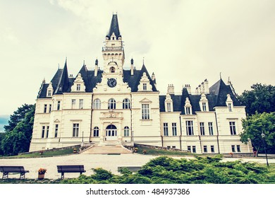 Beautiful Budmerice castle in Slovak republic. Architectural theme. Yellow photo filter. Travel destination. Cultural heritage. Beautiful place.
