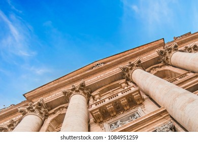 Beautiful building with columns and sculptures, view upwards