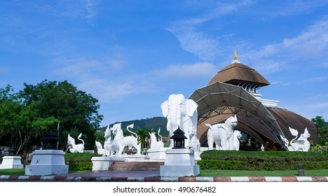A Beautiful building and  fairy tale animal in front of Chiang Mai Night Safari, Thailand on a Clear and Blue Sky Background