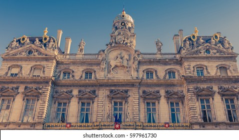 Beautiful building with many white statue and big window, theater in Lyon