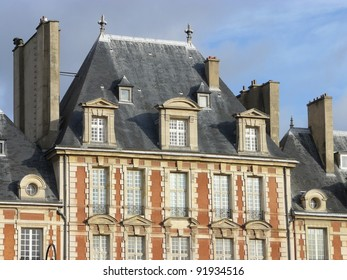 Beautiful buildings of Place des Vosges, square in Paris, France, third arrondissement near Le Marais.