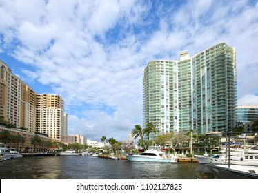 Beautiful buildings, water and boats spanning the North and South banks of Fort Lauderdale's New River.