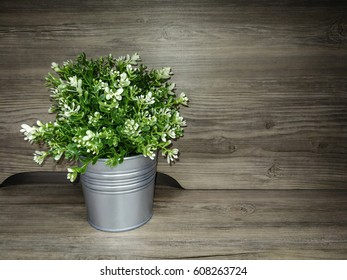 Beautiful bunch of flowers on wooden background.