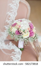 Beautiful bunch of flowers over a chair