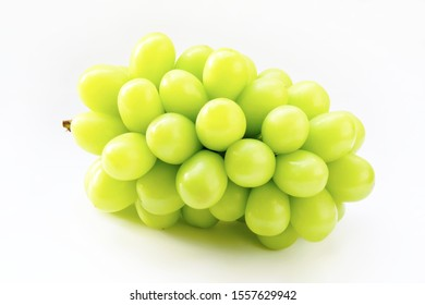 Beautiful bunch of green Muscat grape on white background