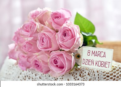 beautiful bunch of pink roses with text written in polish language on paper label -March 8th Women`s Day