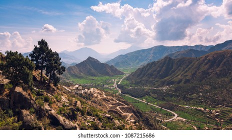 Beautiful Buner valley in Pakistan is covered by tall hills from all sides and winding way