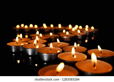 Beautiful burning candles on dark background, closeup